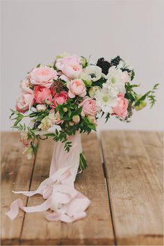 stunning pink and ivory bouquet featuring roses and anemones by Wilder Floral Co
