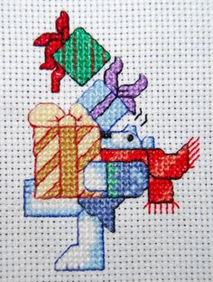 Christmas Cross stitch - bear juggling presents