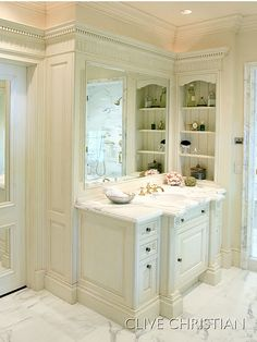 This bath is too formal for me, however..... I love the beadboard shelf on the side o the vanity.  This is obviously built into the studs in the wall a few inches - which is a really great idea and space saver.