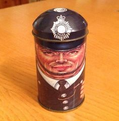 What you see here is a metropolitan police tin from the Cap-Tin collection. Designed by Daher for the Tin Box company of England. It is in very good condition. It has some wear where the lid rubs going on and off.