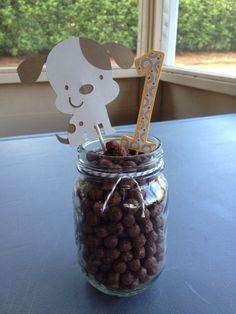 """dog themed birthday party. table centerpiece. """"dog food"""" out of Coco Puffs!"""