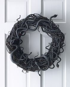 "Wriggling Snake Wreath - the whole thing is wriggling. It reminds me of the TV show ""Salem"""