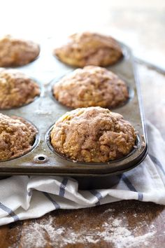 Healthy Cinnamon Sugar Apple Muffins - whole wheat, coconut oil, less sugar, and loaded with apple deliciousness! 230 calories. | pinchofyum.com #apple #muffin #recipe #healthy