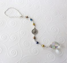 Celestial Sun Crystal Bead Suncatcher / Car Charm. $7.99, via Etsy. glass beads: http://www.ecrafty.com/c-2-glass-beads.aspx