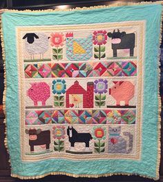 Vintage Farm Girl block quilt I made for my daughter's baby. Had to improvise a little - made our own horse pattern because Bee in My Bonnet didn't have one. (We raise black Shire draft horses and it wouldn't be right not to have a horse on it!)