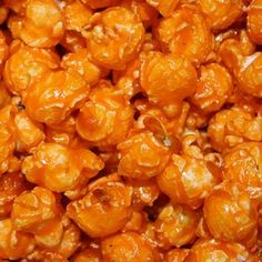 Our freshly popped gourmet orange flavored Popcorn is candy coated. This orange popcorn is great for a mix of team or corporate colors and wedding buffets for your upcoming events! Delicious, fluffy f