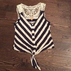 Sleeveless w/lace Navy and white stripe, size medium. Cute tie at the waist, lace on the back. Great condition! Tops