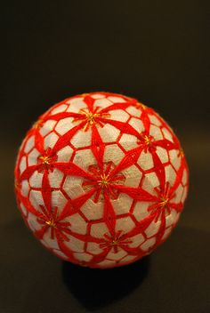 Japanese tamari ball // Red and white geometric flower pattern // by NanaAkua via Flickr