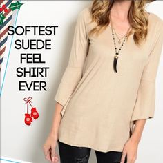 Asymmetrical Sleeve Softest Suede Feel Shirt Ever! This shirt is so soft and comfortable. It has a suede like feel to the material with a gorgeous flowy asymmetrical sleeve. I have S, M, L and XL. Fits true to size. Made of 92% Polyester and 8% Spandex. Just as soft on the inside as it is on he outside. Perfect to wear with leggings, jeans or dress pants. Dress it up or down, up to you. Price is firm unless bundled with another listing. Tops Blouses