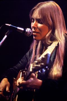 Joni Mitchell started playing ukulele when she was 14. When she picked up a guitar she wasn't able to shape her fingers into the proper chords due to polio. Joni created her own alternative ways of plying which has given her the title of most influential female guitarist of the 20th century. And look at those cheekbones! #SexiestFemaleMusicians #GirlsWhoPlayInstruments