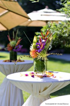 Lush tropical cocktail table arrangements and umbrellas make for a luscious wedding getaway...even if you live in Central California!