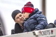Tom Brady of the New England Patriots celebrates with his son Benjamin during the Super Bowl victory parade on February 7, 2017 in Boston, Massachusetts. The Patriots defeated the Atlanta Falcons 34-28 in overtime in Super Bowl 51.