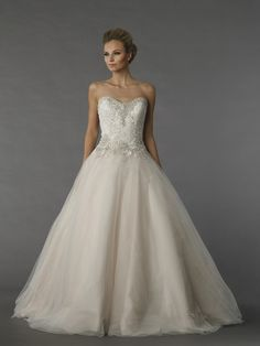 Danielle Caprese 113078  This ball gown features a sweetheart neckline with a natural waist in tulle and beaded embroidery. It has a chapel train.