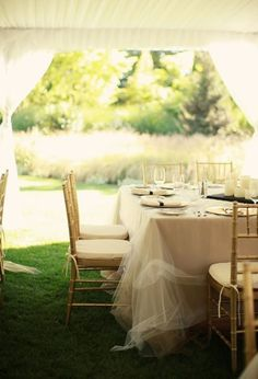 Wedding table idea with swagging tulle xo
