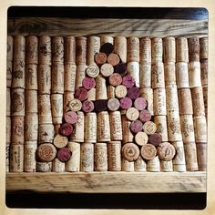 - WINE CORK NOTICE BOARDS  Up-cycling at it's best! Unique pin boards filled with interesting wine bottle corks.  They are made to order with bespoke frames made from re-claimed wood.  Perfect as a gift or to pin your table plan onto.  Can be personalised as pictured with a letter of your choice in either portrait or landscape. Frames are 65cm x 28cm  but other shapes and sizes can be made to order,  just get in touch for a quote.