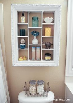 DIY bathroom makeover with an over the toilet storage unit repurposed from an old picture frame.