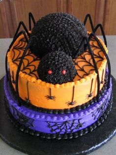 "Halloween Birthday - 12"" and 10"" tiers with sports ball and mini ball pan spider. All iced in buttercream."