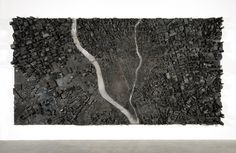 "Matthew Day Jackson, ""August 9, 1945,"" 2011, scorched wood and lead on panel, 96 x 186 x 14 In./ 243.8 x 472.4 x 35.6 cm"