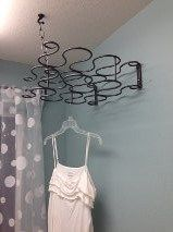 Old wine rack for hanging air dry clothes in laundry.