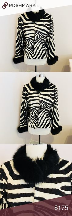 Zebra jacket with real fur at collar & wrists EUC Gorgeous Zebra looking jacket with real fur at collar and wrists. In excellent used condition. Clasp at collar and at bust area. Jacket hits at hip area. Jackets & Coats Utility Jackets