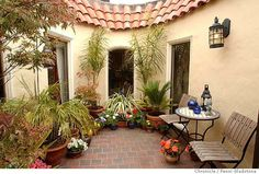 Image from http://thehomedecorz.com/wp-content/uploads/2014/06/brightening_the_sunset_spanish_style_homes_with_courtyards_oliver_rousseau_a_depression-era_builder.jpg.