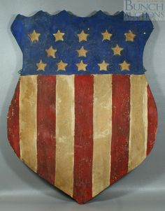"""American carved and painted wood thirteen star flag shield, 23"""" x 30 1/2"""""""