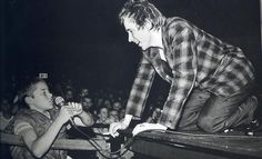 John Lydon reaches his mic to a kid