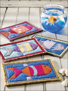 A Little Fishy FREE quilt potholder pattern download. Find this pattern at Free-Quilting.com.