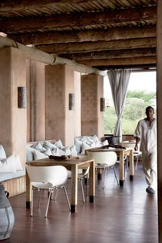 This beautiful resort in the Namibian bush looks like a wonderful place for a holiday and we noticed that the owners have selected Tom Vac chairs for the dining areas and guest rooms Ron Arad, Interior Architecture, Interior And Exterior, Interior Design, Public Hotel, Game Lodge, Wooden Dining Tables, Wooden Decks, Cafe Restaurant