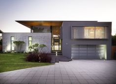 "Residential Architecture: The 24 House by Dane Design Australia: ""..This site has a deep frontage and wide verge; this has been used to its advantage to set the home well back from the road. Settling the home into the site has been taken further by opting for a low profile appearance..To help achieve a subtle street frontage not dominated by garage doors, the garage has been pushed down into the site. The garage, cellar and service access is approximately 1.5m below natural ground levels…"