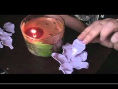 Shut up.  How to make a flower out of melted plastic spoons.  Crafts and fire together?  Awesomeness.