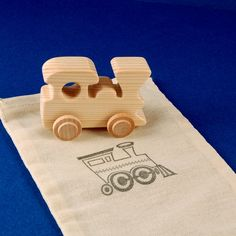 Train Party Favors - Package of 5 Natural Wood Toy Locomotives with Goodie Bags - Great for Toddler and Kids Parties. $19.00, via Etsy.