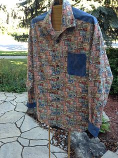 Stamp collecting shirt that I made using Northcott fabric. Made by Ruthie Snell.