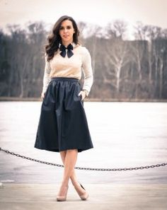 Black bow tie with cardigan and midi black skirt. Learn more about how to wear a bow tie >>> http://justbestylish.com/9-tips-how-to-wear-a-bow-tie-for-women/
