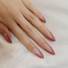 Long pointed fingernails with a nude geometric manicure