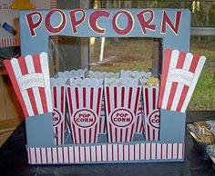 This is a very inventive popcorn dispenser made from a cardboard box!