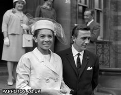 8 June 1961: Singer Shirley Bassey, from the Tiger Bay area of Cardiff, and film director Dr. Kenneth Hume, leave after their wedding at Paddington Register office. Shirley is wearing a pink costume with toque hat and veil to match.