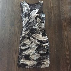 BCBG black grey and white feather patterned dress This very sexy BCBG dress is black, grey, and white that is a feather patterned that is rouched throughout. The right side neckline is cut out to accentuate a tiny hint of décolletage. BCBGMaxAzria Dresses