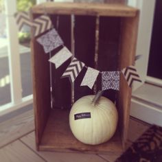Crates, white pumpkins and cute bunting. Fall decor.
