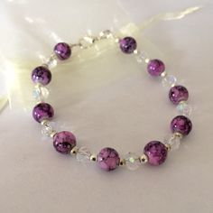 A personal favourite from my Etsy shop https://www.etsy.com/listing/231787817/purple-drawbench-and-glass-bead-bracelet