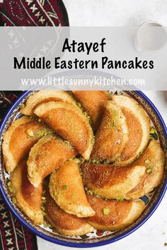 Atayef or Qatayef are Middle Eastern pancakes filled with white cheese or nuts then soaked in a rose sugary syrup. They are only made and served during the Holy month of Ramadan. Here's a detailed recipe to make Atayef from scratch. Lebanese Desserts, Lebanese Recipes, Turkish Recipes, Middle Eastern Desserts, Middle Eastern Dishes, Middle Eastern Vegetarian Recipes, Easy Dinner Recipes, Easy Meals, Brunch Recipes