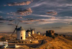 The watchers of Toledo...  - Pinned by Mak Khalaf sunrise over Consuegra and its mills. thanks very much for your visits and coments. Landscapes amanecercerrocielocloudscolormillsmolinosnubesskyspainsunrise by manubili10