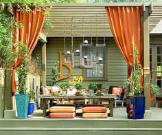 Consider Curtains for Backyard Privacy.  On this colorful deck, weatherproof curtains were hung on the pergola to create privacy and add protection from the sun. The curtains also help block the wind so food and drinks don't blow off the table.