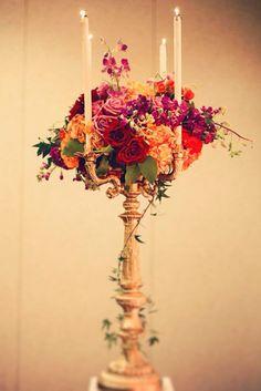 A tall gold candelabra  a stunning floral bouquet provides an elegant wedding centerpiece. Source: Simply Devine Events. #centerpiece #candelabra #gold