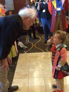 """Colin Baker and mini Colin Baker. Colin: """"You're probably the only one who could make that outfit look good."""""""