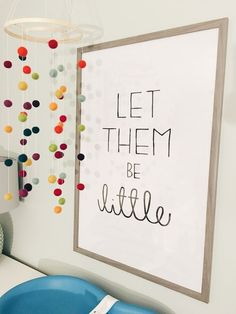 colored pom poms would be cute to hang or even set on the table as decor around the albums