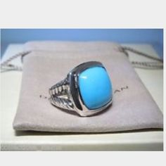 David Yurman 925 turquoise 14mm Albion ring Authentic David Yurman 14mm Albion ring; split shank; turquoise stone; size 9--great for pointer or middle finger, but can be sized as well; great condition; comes with original DY bag and dost cloth; purchased at Saks Fifth Avenue. Originally $875.      PRICE FIRM!! David Yurman Jewelry Rings