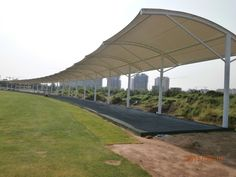 This Golf Shade Canopy adopts the roofing frame of steel structure, and membrane is stretched above it, and the column is stable. This shape is suitable for swimming pools, golf courses, tennis courts and other sports shades area. Fabric Structure, Roof Structure, Steel Structure, Haikou, Pvc Roofing, Golf Range, Roof Coating, Tensile Structures, Shade Canopy