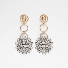 Aldo Uniria. Pretty and packed with elegance – celestial bursts of stones add dash of everyday glamour on these dangling chandelier earrings.