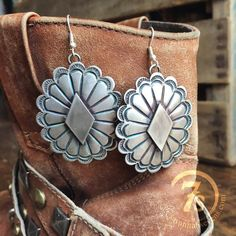 """Antiqued silverconcho earrings Oval rosette with raised diamond shape center Hook style 2"""" long concho"""